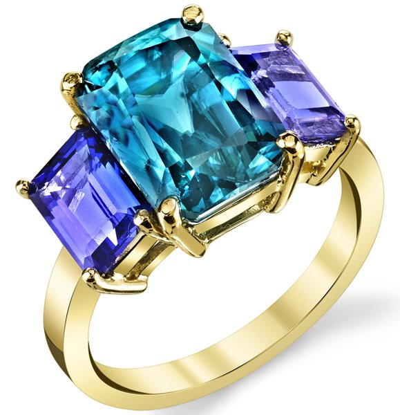 Enchanting 7.65ct Radiant Blue Zircon 3 Stone Ring With Baguette Cut Tanzanite Side Gems - 18kt Yellow Gold
