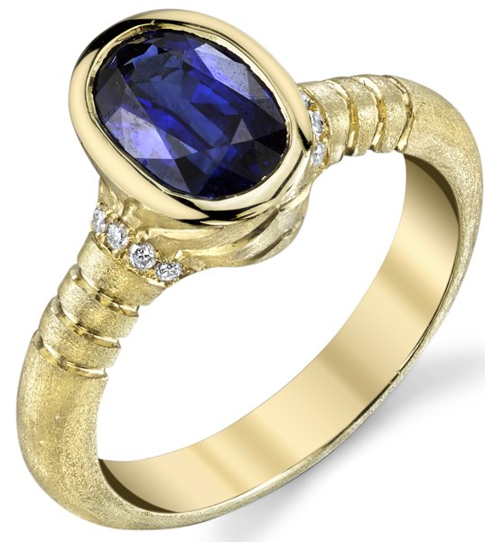 Fashionable Handmade Bezel Set 18kt Yellow Gold 1.85ct Blue Sapphire Fashion Ring With Diamond Accents Satin Finish