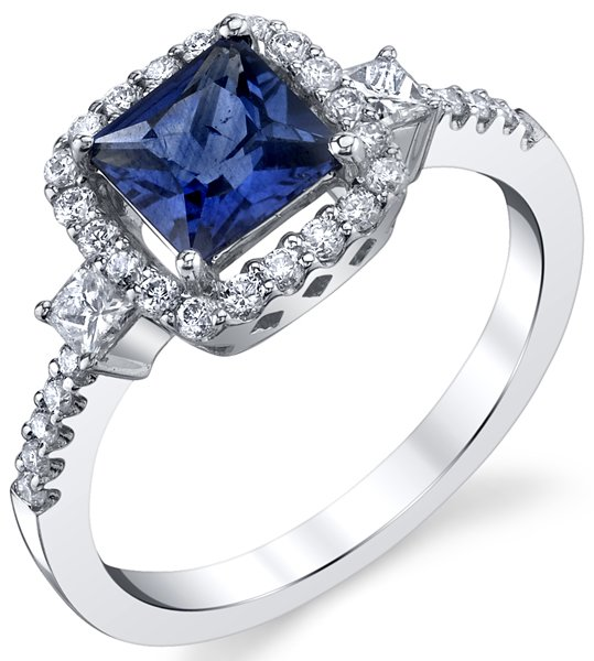 Super Classy 6mm Princess Cut Blue Sapphire Ring With Princess Diamond Sidegems & Diamond Accents - 18kt White Gold