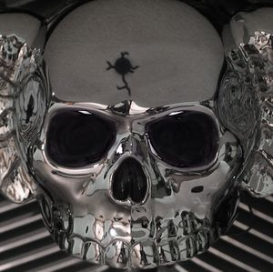 Chrome Winged Skull with Bullet Hole