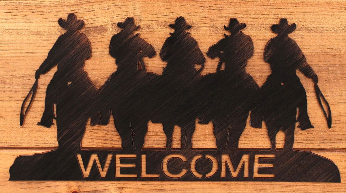 Iron Cowboy Welcome Sign