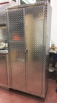 30 inches wide by 20 inches deep by 66 inches tall Diamond Plate Locker