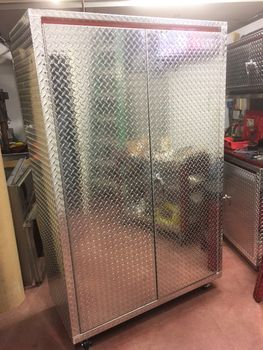 48 inches wide by 22 inches deep by 72 inches tall Diamond Plate Locker