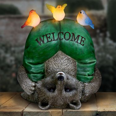 Silly Solar Welcome Raccoon w/Birds - Click to enlarge
