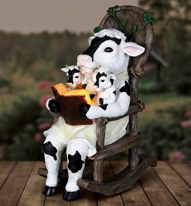 Solar Cows Reading in Rocking Chair - Click to enlarge