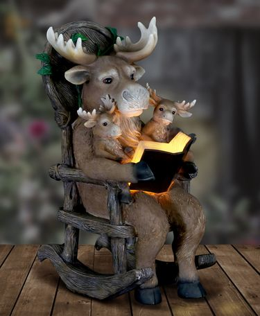 Solar Moose Reading in Rocking Chair - Click to enlarge