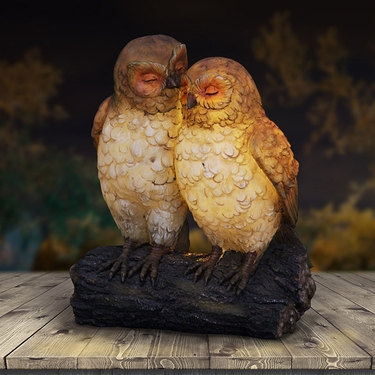 Solar Owl Pair on Stump - Click to enlarge