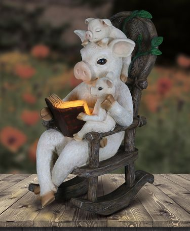 Solar Pigs Reading in Rocking Chair - Click to enlarge