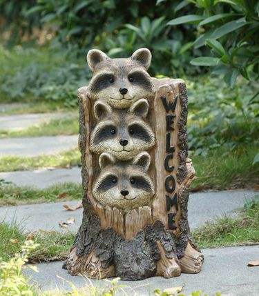 Stacking Raccoons in Stump Statue - Click to enlarge