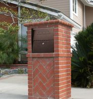Small Package Locking Column Mailbox in Brick Column