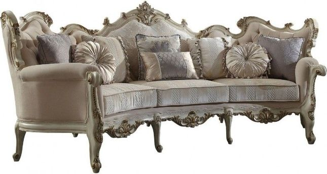 Curved Wingback On Tufted Sofa