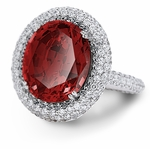 Alessandria 6.5 Carat Oval Man Made Ruby Gemstone with a Pave Set Round Cubic Zirconia Halo