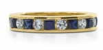 Alternating Man Made Sapphire Princess Cut and Cubic Zirconia Round Channel Set Eternity Band