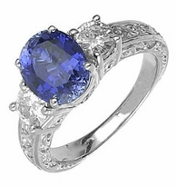 Benton 1.5 Carat Cubic Zirconia Oval Lab Created Sapphire Three Stone Estate Style Ring