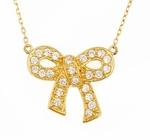 Bow Tied Ribbon Cubic Zirconia Pave Set Round Pendant