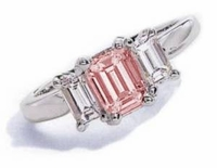 The Jen Ring Inspiration 2.5 Carat Pink Emerald Step Cut Cubic Zirconia Three Stone Solitaire Engagement Ring