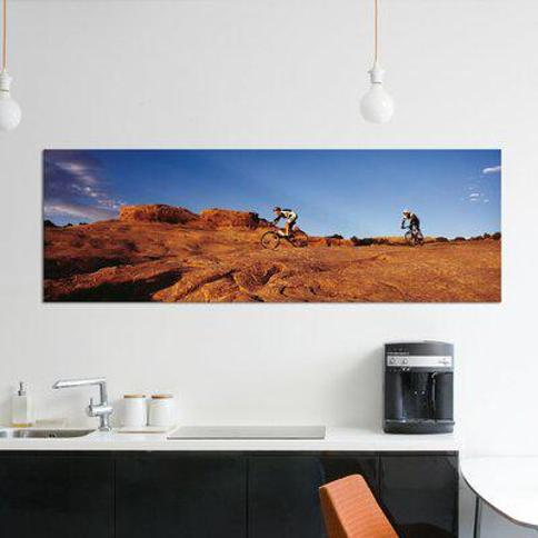 "East Urban Home 'Two People Mountain Biking Moab Utah USA' Photographic Print on Canvas FTCI8485 Size: 16"" H x 48"" W x 1.5"" D"