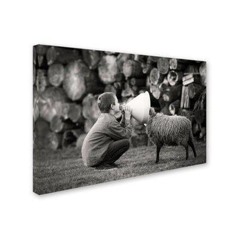 """Trademark Fine Art 'The News' Photographic Print on Wrapped Canvas 1X03354-C Size: 30"""" H x 47"""" W"""