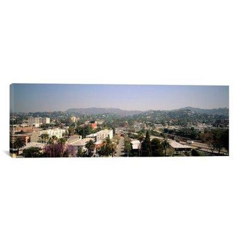 """East Urban Home 'Buildings in a City Hollywood City of Los Angeles California' Photographic Print on Canvas FBTV5123 Size: 16"""" H x 48"""" W x 1.5"""" D"""