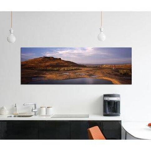 """East Urban Home 'Mountain Bike Riders on a Trail Slickrock Trail Sand Flats Recreation Area Moab Utah Usa' Photographic Print on Canvas FTCI8276 Size: 16"""" H x 48"""" W x 0.75"""" D"""