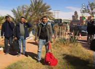 An image from Algeria's Al-Jazairia 3 TV on January 18, 2013 shows Algerian hostages after they fled their Islamist captors following a deadly raid by Algerian forces at a desert gas field in In Amenas