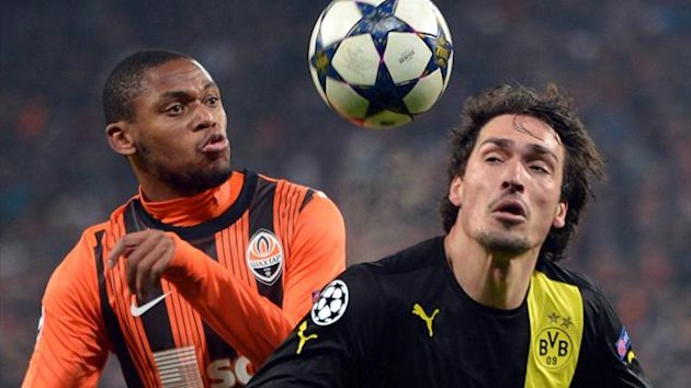Luiz Adriano of Shakhtar fights for a ball with Mats Hummels of Borussia Dortmund during their Champions League last 16 match (AFP)
