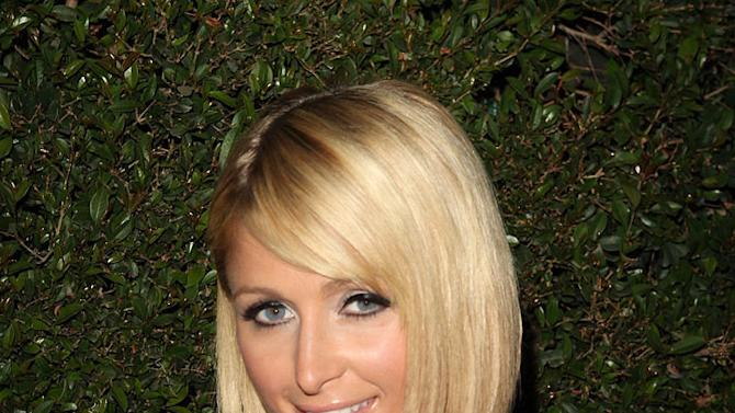 Paris Hilton arrives at the T-Mobile Sidekick LX launch event at Paramount Studios, one of 6 simultaneous launch events celebrating the new device, on May 14, 2009 in Los Angeles, California.