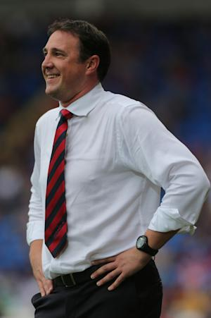 Peter Whittingham's hat-trick left Malky Mackay, pictured, smiling as Cardiff secured all three points