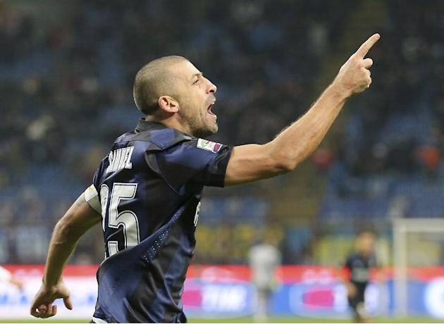 Inter Milan Argentine defender Walter Samuel celebrates after scoring during the Serie A soccer match between Inter Milan and Sassuolo at the San Siro stadium in Milan, Italy, Sunday, Feb. 9, 2014
