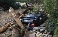 A flood-destroyed car lies submerged in mud and debris in Jamestown, Colorado, after a flash flood destroyed much of the town, September 14, 2013. REUTERS/Rick Wilking