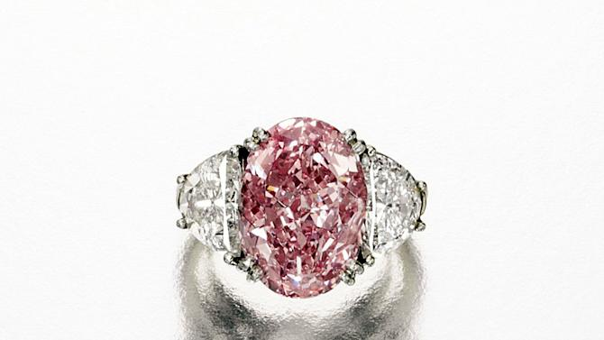 This undated photo provided by Sotheby's shows a rare Fancy Intense Pink diamond ring weighing 6.54 carats, that has a pre-sale estimate of $4 million to $5 million.  It is among a trove of jewels from the collections of Estee and Evelyn Lauder that will be auctioned to benefit breast cancer research on Dec. 5. (AP Photo/Sotheby's)