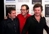 Kirk Pengilly (C) with other INXS band members Andrew Farris (L) and Tim Farris (R) in 1999