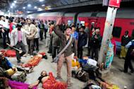 A man denounces the police as the cause of the stampede that killed one of his relatives, at the main railway station serving India's giant Kumbh Mela festival, in Allahabad, on February 10, 2013. At least 36 people died in a terrifying stampede as pilgrims headed home from the festival, which drew a record 30 million people to the banks of the Ganges