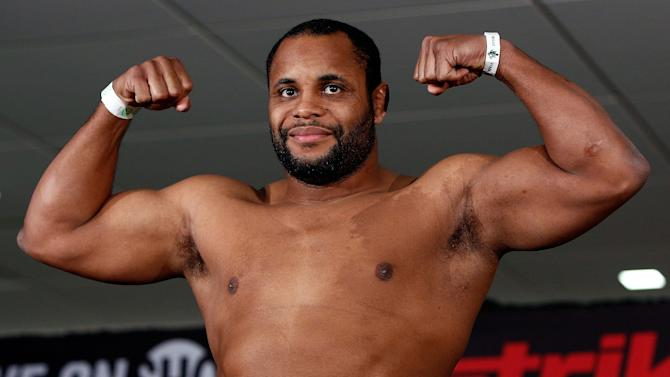 Daniel Cormier flexes at a weigh-in. (Getty)