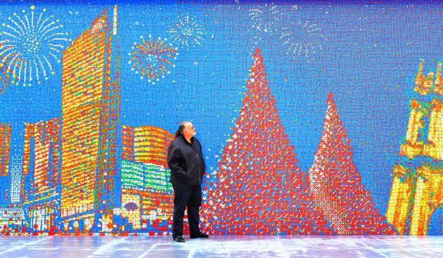 China now has two spectacular great walls. Josh Chalmon stands in front of a giant mosaic made from 85,794 Rubik's Cubes, Macau, China. The wall is 220ft long and 13ft tall and shows the skyline o