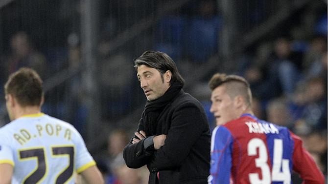 Basel's head coach Murat Yakin watches play during a Champions League group E group stage match between Switzerland's FC Basel 1893 and Romania's FC Steaua Bucharest at the St. Jakob-Park stadium in Basel, Switzerland, Wednesday, Nov. 6, 2013