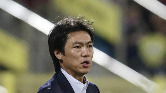 South Korea's head coach Bo Myung Hong reacts during the international friendly soccer match between Russia and South Korea, in Dubai, United Arab Emirates, Tuesday, Nov. 19, 2013