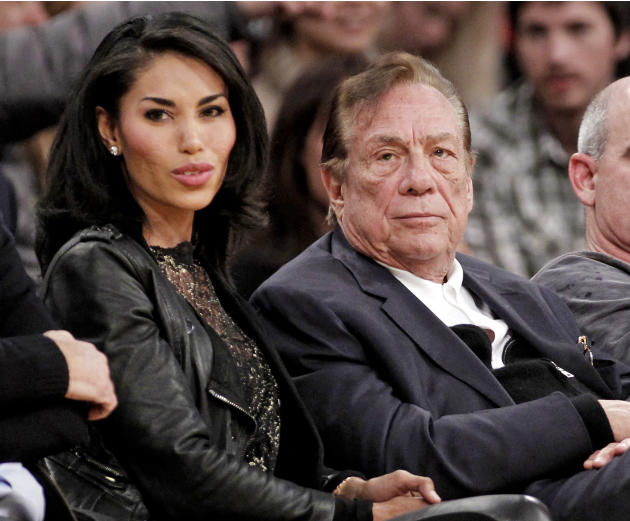 FILE - In this Dec. 19, 2011, file photo, Los Angeles Clippers owner Donald Sterling, right, sits with V. Stiviano as they watch the Clippers play the Los Angeles Lakers during an NBA preseason basket