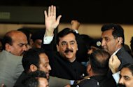 Pakistan's former prime minister Yousuf Raza Gilani (C) is seen outside the Supreme Court building in Islamabad in April 2012. Gilani was dismissed for refusing to reopen corruption cases against President Asif Ali Zardari. His son, Abdul Qadir Gilani, won a by-election on Thursday in the family constituency in the central town of Multan