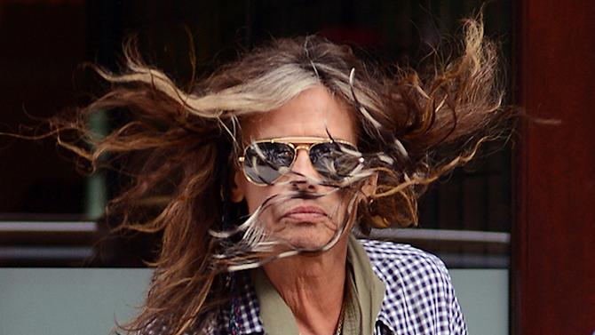 Steven Tyler Has Wind Blown Hair & Blue Nail Polished Toes