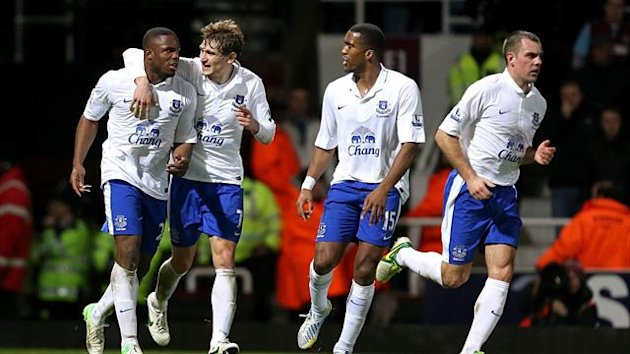 Everton's Victor Anichebe (left) celebrates scoring his teams first goal of the game with teammates (PA Sport)
