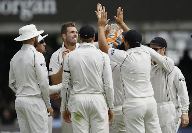 New Zealand's Tim Southee, third left, celebrates taking the wicket of England's Ian Bell during the fourth day of the first Test match between England and New Zealand at Lord's cricket gr