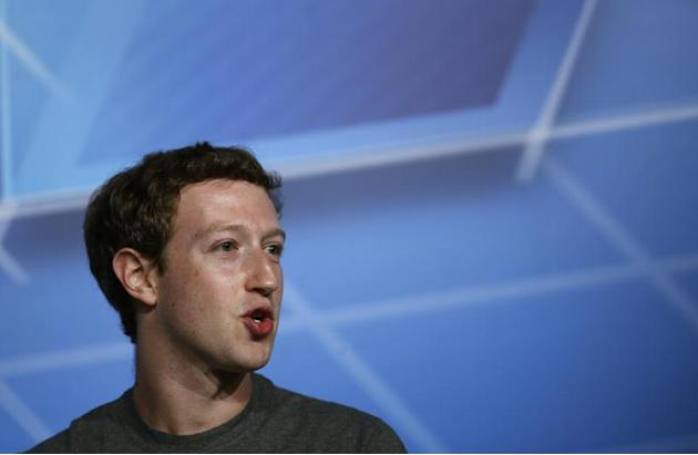 Facebook CEO Zuckerberg smiles in the stage before delivering a keynote speech during the Mobile World Congress in Barcelona