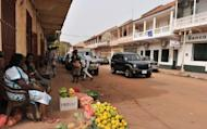 Residents going about their daly life on a street in Bissau, in March 2012. Guinea-Bissau troops staged a coup attempt late Thursday, attacking the prime minister's residence and taking over ruling party headquarters and the national radio station