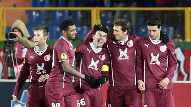 Rubin Kazan's Bebras Natcho, centre, with his team members celebrate after scoring a goal against Zulte Waregem, during their Europa League Group D soccer match in Kazan, Russia, Thursday, Oct. 3, 2013