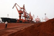 Rare earths to be loaded on to a ship at a port in Lianyungang, east China's Jiangsu province, for export to Japan, September 2010. China, which is locked in a dispute with major trading partners over its control of rare earth minerals, on Thursday announced additional export quotas for this year