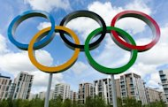 The London 2012 Olympic Athletes Village is pictured through the Olympic Rings in east London. Seven competitors from Cameroon have gone missing at the London Olympics and British police have been informed, a spokeswoman for Games organisers LOCOG confirmed