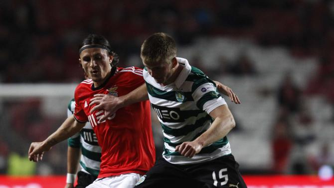 Benfica's Ljubomir Fejsa fights for the ball with Sporting's Eric Dier during their Portuguese Premier League soccer match at Luz stadium in Lisbon