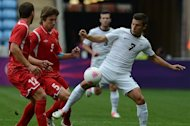 Belarus's Baga Dmitry (C) and Kozlov Aleksei (L) vies with New Zealand's Barbarouses Kosta (R) during the 2012 Olympic Men's football match between Belarus and New Zealand on July 26, 2012 at The City of Coventry Stadium in Coventry, central England. AFP PHOTO / KHALED DESOUKI