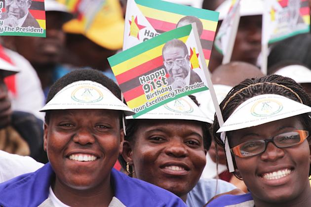 Supporters of Zimbabwes President Robert Mugabe take part in celebrations to mark his 91st birthday in the resort town of Victoria Falls, Saturday Feb, 28, 2015. Mugabe turned 91 on the 21st of Februa